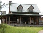 Деревянный дом с каменным цоколем