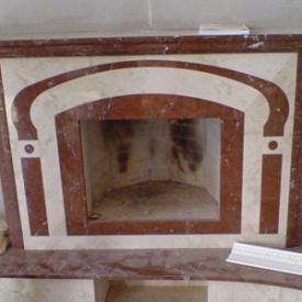 Угловой камин из мрамора Анатолия Браун