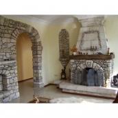 Установка арки з каменю в стіні