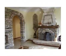Установка арки из камня в стене