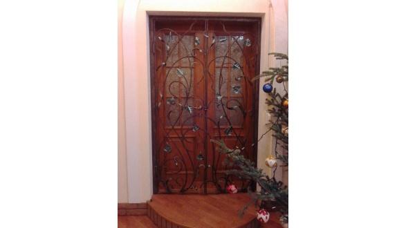 Кованые дверные решетки