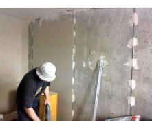 Штукатурка стен по маякам 25 мм