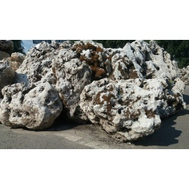 Камень известняк дырчатый насыпом серый