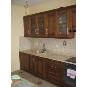 Кухня прямая в деревенском стиле с декоративными фасадами и вставками из матового стекла