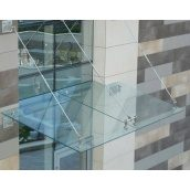 Скляний дашок на тягах з підконструкцією