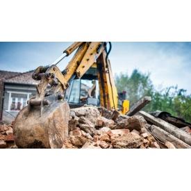 Дробление строительных материалов после демонтажа дробильним ковшом