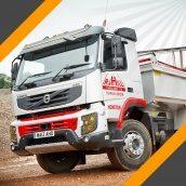 Вантажні перевезення сипучих матеріалів самоскидом з напівпричепом 40 т