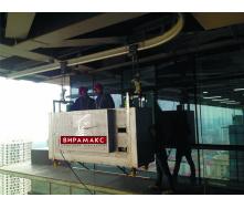 Система обслуговування фасадів будівель на монорельсовому ходу по типу BMU