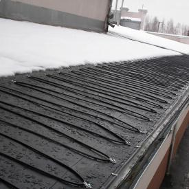 Установка системы антиобледенения на крыше в водостоках на лестницах и открытых площадях