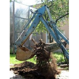 Корчевка пней деревьев на участке
