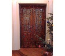 Кованая дверная решетка