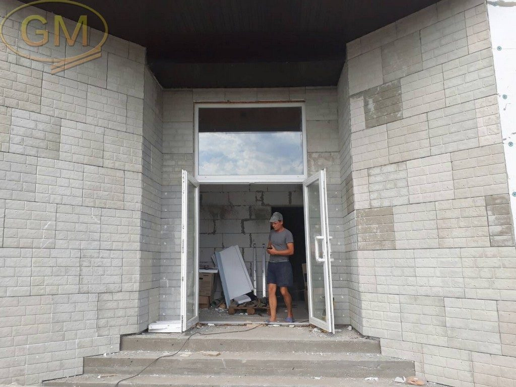 Утеплення фасадними термопанелями
