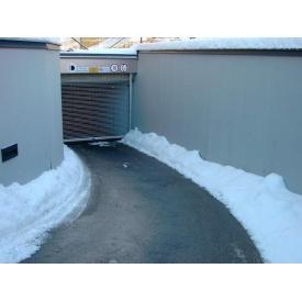 Установка системы снегостаивания на дороге