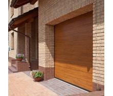 Секційні гаражні ворота ALUTECH TREND М-гофр 3000х2375 мм золотий дуб