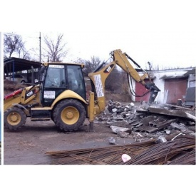 Демонтаж стены гидромолотом CAT H65