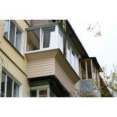 Обшивка виносу балкона сайдингом