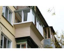 Обшивка выноса балкона сайдингом