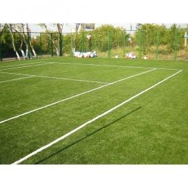 Укладка искусственной травы для игры в большой теннис