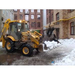 Розчищення снігу екскаватором